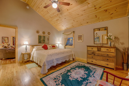 Bedroom one with private bathroom in Mountain Creek Cabin in Maggie Valley, NC