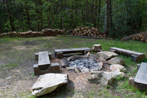 Fire pit and meadow in Mountain Creek Cabin in Maggie Valley, NC