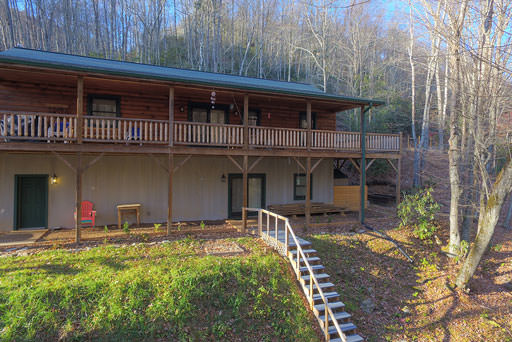 Front view of cabin and deck in Mountain Creek Cabin in Maggie Valley, NC