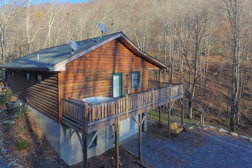 Side view of cabin and hot tub in Mountain Creek Cabin in Maggie Valley, NC