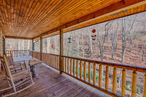 Full wrap around deck in Mountain Creek Cabin in Maggie Valley, NC